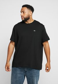 Lacoste - PLUS SIZE - Basic T-shirt - noir - 0