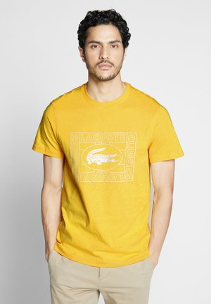 TH5097-00 - T-shirt con stampa - yellow