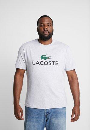 T-shirt med print - argent chine