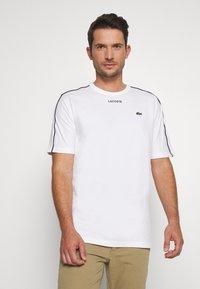 Lacoste - T-shirt imprimé - weiss - 0
