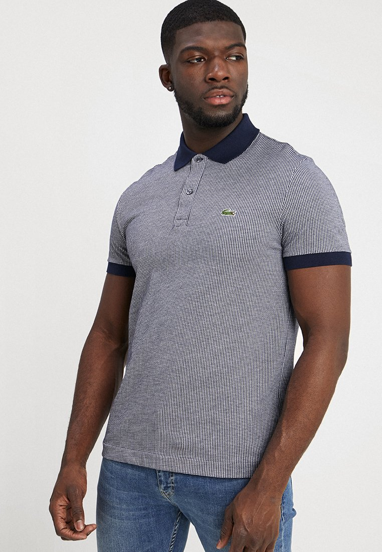 Lacoste - Polo shirt - navy blue/white