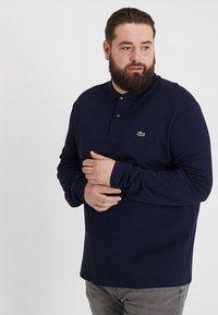 Lacoste - Polo shirt - marine - 0