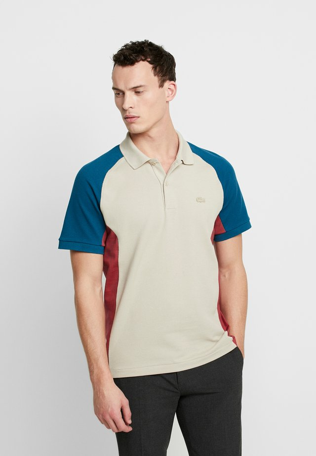 Poloshirt - beige/dark blue/red