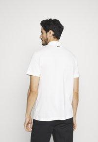 Lacoste - Polo shirt - flour - 4