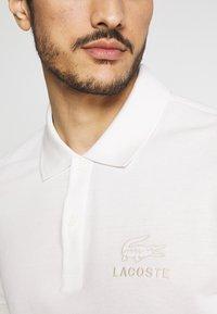 Lacoste - Polo shirt - flour - 8