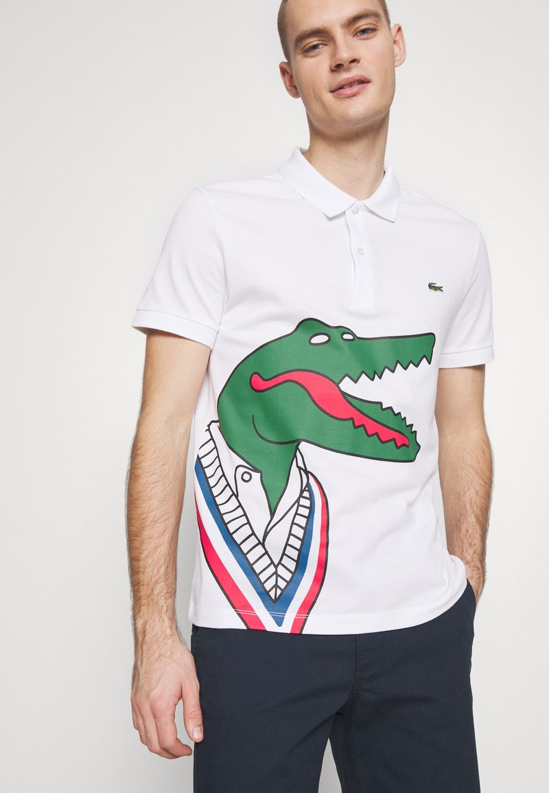 Lacoste - Unisex Lacoste x Jean-Michel Tixier Print Classic Fit Polo Shirt - Poloshirt - blanc/rouge