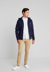 Lacoste - veste en sweat zippée - navy blue - 1