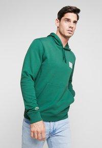 Lacoste - SH5167 - Hoodie - dark green - 0