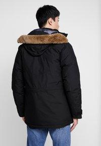 Lacoste - Down coat - black/graphite - 2