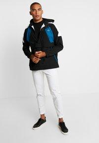 Lacoste - Lehká bunda - black/illumination/white - 1