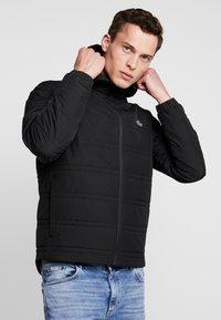 Lacoste - Lehká bunda - black - 0
