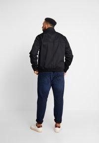 Lacoste - Lehká bunda - black - 2