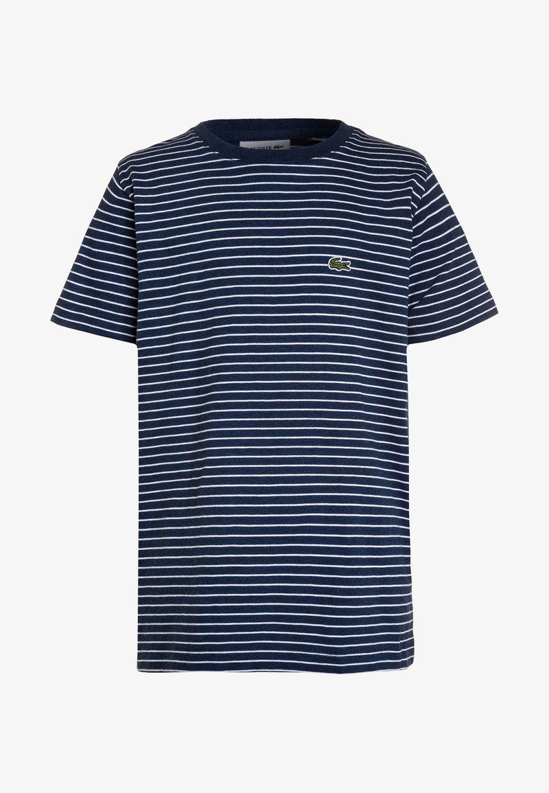 Lacoste - T-shirt con stampa - matelot chine/white