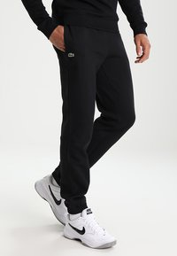 Lacoste Sport - Pantalon de survêtement - black - 0