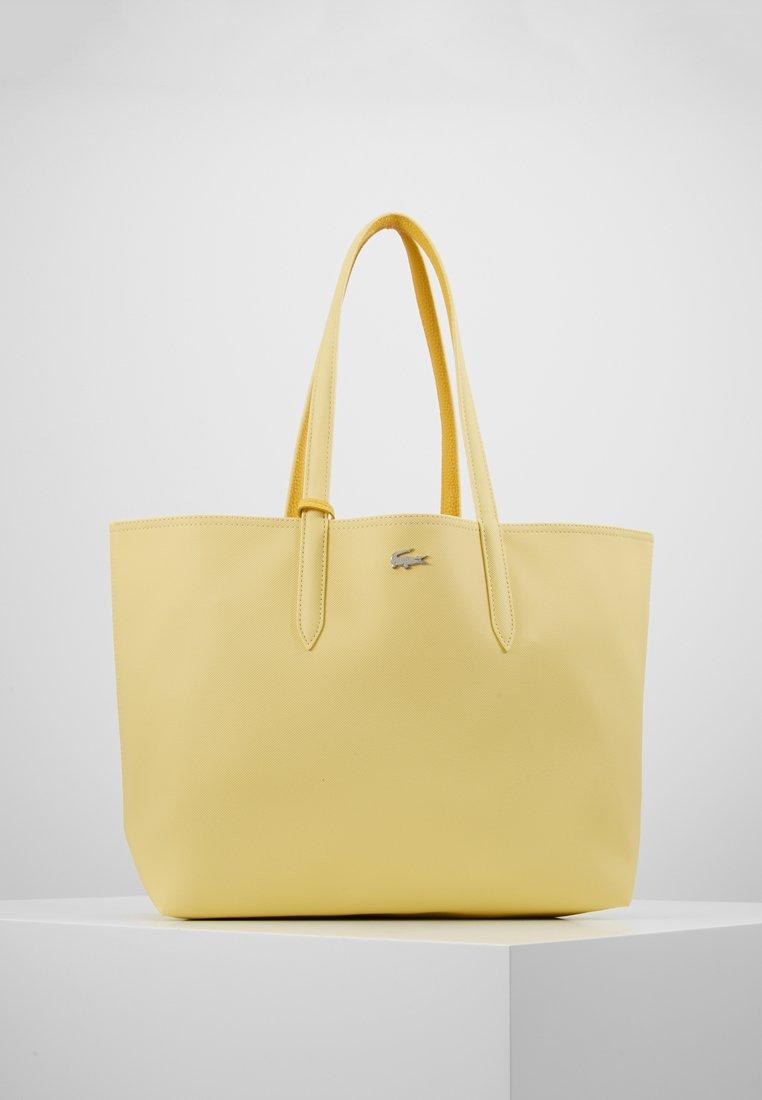 Lacoste - REVERSIBLE  - Shopping bags - pale banana/yolk yellow