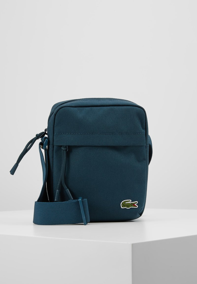 Lacoste - VERTICAL CAMERA BAG - Across body bag - reflecting pond