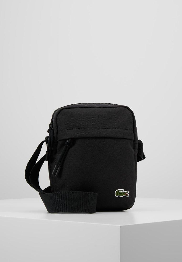 Lacoste - VERTICAL CAMERA BAG - Across body bag - black