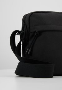 Lacoste - VERTICAL CAMERA BAG - Across body bag - black - 7