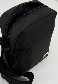 Lacoste - VERTICAL CAMERA BAG - Across body bag - black - 4