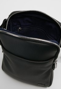 Lacoste - FLAT CROSSOVER BAG - Across body bag - black - 4