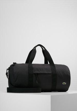 ROLL BAG - Sports bag - black