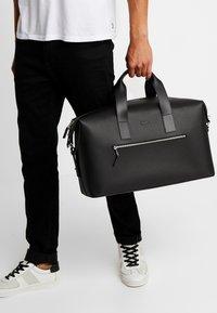 Lacoste - Weekend bag - black - 1