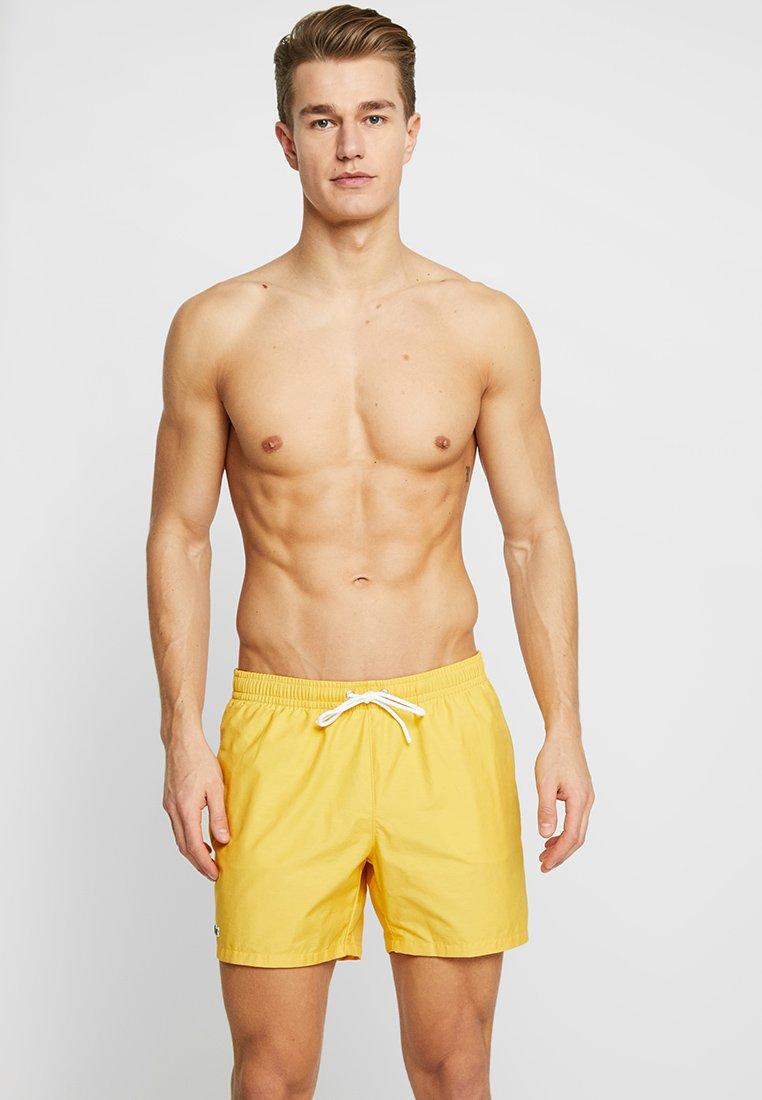 Lacoste - Swimming shorts - physalis/creek