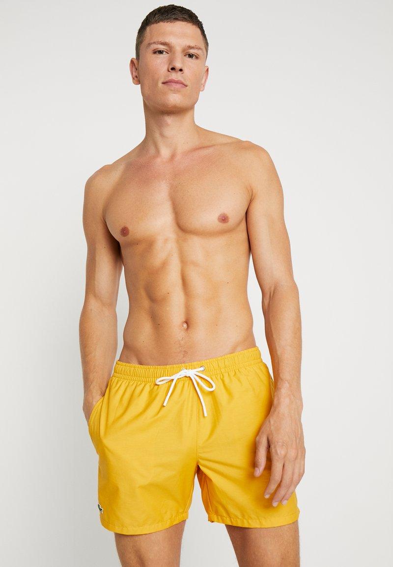 Lacoste - Swimming shorts - oxy