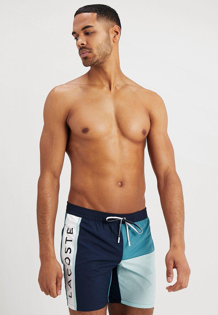Lacoste - Swimming shorts - navy blue/tide blue aquarium/white