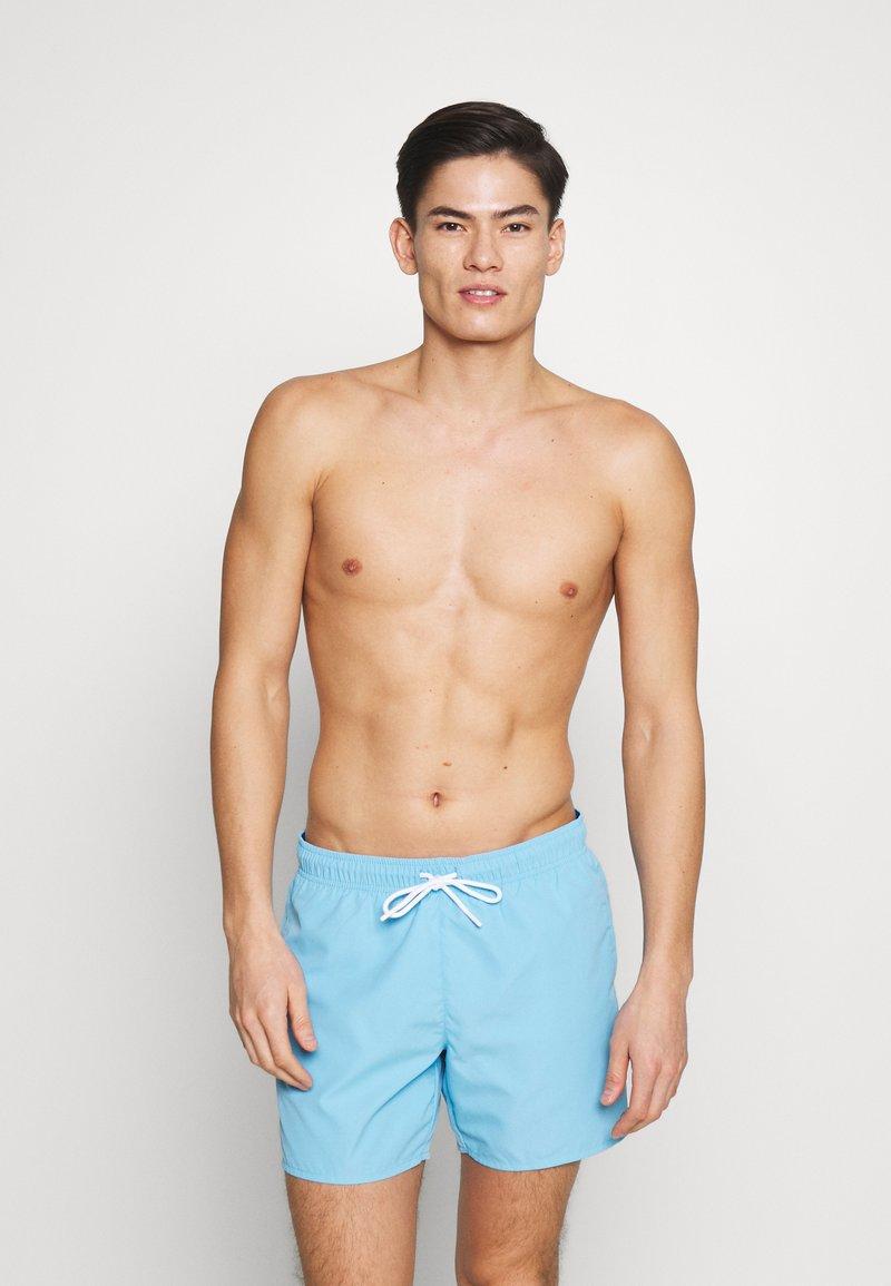 Lacoste - Swimming shorts - barbeau/electrique