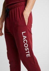 Lacoste - JOGGER - Pyjama bottoms - burgundy - 6