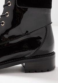 L'Autre Chose - Lace-up ankle boots - black - 2