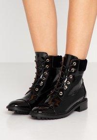 L'Autre Chose - Lace-up ankle boots - black - 0