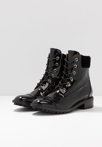 L'Autre Chose - Lace-up ankle boots - black - 4
