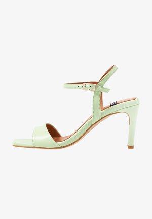 High heeled sandals - tibet plant