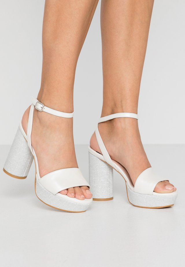 High heeled sandals - white/silver