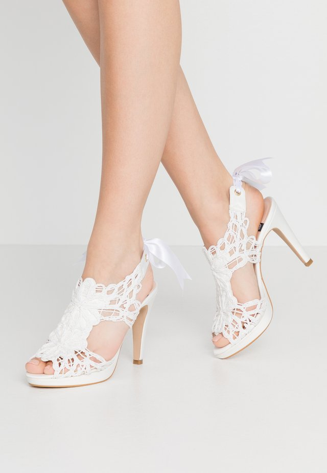 High heeled sandals - white