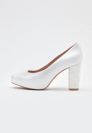 High heels - fantasia blanco