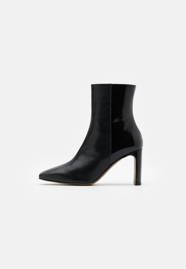 COMBI - Classic ankle boots - black