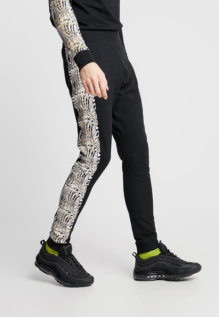 Ladron De Jeans - GANDO SIDEPRINT PANT - Jogginghose - black
