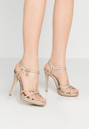 High heeled sandals - star light gold