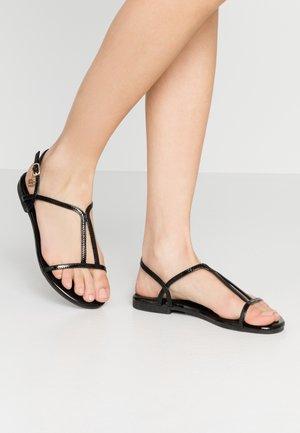 Sandaalit nilkkaremmillä - mirror black