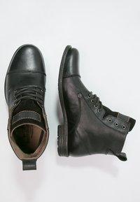 Levi's® - EMERSON  - Bottines à lacets - regular black - 1