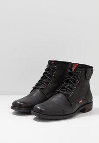 Levi's® - FOWLER - Bottines à lacets - regular black - 2