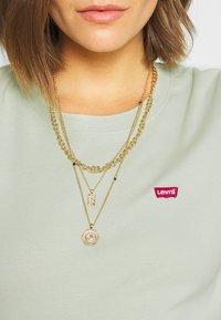 Levi's® - BABY TEE - T-shirt basic - bok choy - 5