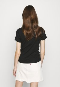 Levi's® - BABY TEE - T-shirt basic - mineral black - 2