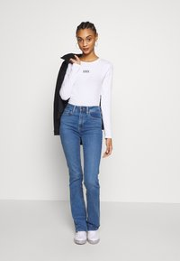 Levi's® - GRAPHIC BODYSUIT - Long sleeved top - white - 1