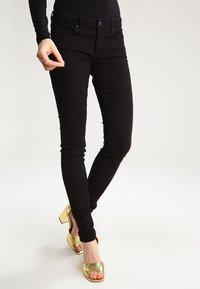 Levi's® - 711 SKINNY - Jeans Skinny Fit - black sheep - 0