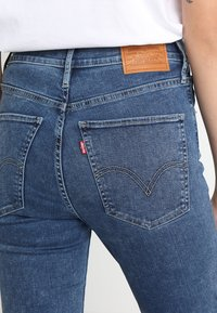 Levi's® - MILE HIGH SUPER SKINNY - Jeans Skinny Fit - blue denim - 4