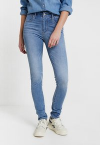 Levi's® - 721™ HIGH RISE SKINNY WHITE DENIM - Jeans Skinny Fit - steal my sunshine - 0